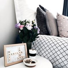 My favourite place, surrounded by reminders of the people I love the most. ❤️ @_lovetildy_ thank you so much for my personalised scrabble frame.  #mainbedroom #scrabble #scrabbleframe #kmartaus #kmartstyling #kmart #sharemystyle #interior #interior123 #marble #flowers #linen #concretecandle #concrete #candle #love #family #friends #mastersuite #masterbedroom #bed #bedroom