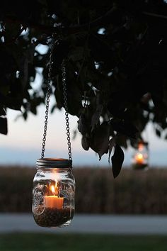 Fall Decorating Ideas: A Harvest Bonfire Party - The Home Depot Super cute and super chic. This DIY mason jar project will help set the mood for any party. Mason Jar Projects, Mason Jar Crafts, Pot Mason Diy, Mason Jar Lanterns, Hanging Mason Jars, Jar Candles, Harvest Party, Bonfire Night, Fall Bonfire