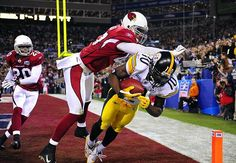 Steelers WR Santonio Holmes makes a leaping touchdown grab with 42 seconds remaining in Super Bowl XLIII to give Pittsburgh a 27-23 win over the Cardinals. (John Biever/SI) GALLERY: The 100 Greatest Sports Photos of All Time