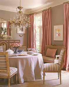 updated fabrics on antique french chairs. Love the pink drapes