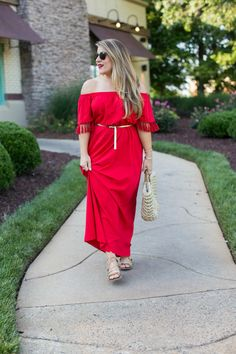 Casual date night outfit - click through for more on this look and for details on our date night featuring On the Border. #PatioVida | date night outfit | summer dress | off the shoulder dress outfit | OTS dress outfit | tassel dress | monochromatic outfit | red dress and red lipstick | red dress makeup | straw bag outfit