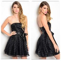 Black Strapless Dress This gorgeous dress is ready for all your party needs! Strapless dress with black satin stripes all over and a satin ribbon tie. The dress is fitted through the bodice and then has an a-line fit. The dress in 65% nylon and 35% cotton. It comes in small, medium, and large. Boutique Dresses Prom