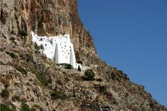 Built 300 meters above sea level and embedded in the rock face of the mountain, Panagia Hosoviotissa is visible only from the sea. It was founded by the Byzantine Emperor Alexios Komninos in Sea Level, Byzantine, Greek Islands, The Rock, Monument Valley, Mount Rushmore, Greece, Mountains, Landscape