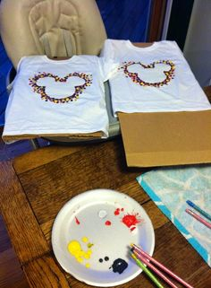 Dot shirts with wax paper stencil. Painting with pencil eraser.