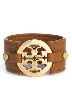 Adding this Tory Burch statement bracelet to the jewelry box. Love the shiny gold logo paired with brown leather.