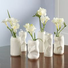 DIY Inspiration - Crumpled Soda Cans upcycled into Flower Vases using Spray Paint.  This is actually pretty cool