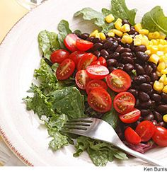 Southwestern Salad With Black Beans - We top salad greens with black beans, sweet corn, and grape tomatoes, and bring it all together with a tangy avocado-lime dressing for a Mexican-inspired salad.