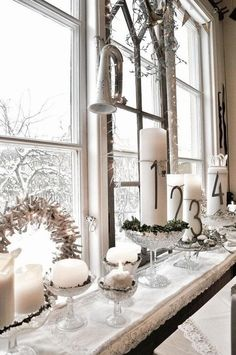 Love this window ledge! Great use of glass compotes as candle holders! And love the numbers on the candles.