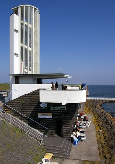 The observation tower is designed by the architect Willem Dudok, built in It is called Vlieter monument, at Afsluitdijk dam, The Netherlands Dutch Netherlands, Kingdom Of The Netherlands, Amsterdam School, Art Deco, Art Nouveau, Unique Buildings, Unique Architecture, Water Tower, Building Design
