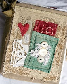 fabric journal cover. vintage laces buttons stitching embroidery inspiration