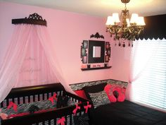 pink zebra nursery. i love the drape over the crib for a girl
