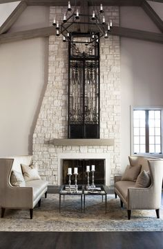 "This living room is chic and eccentric. You simply can't miss the 163"" high Italian 19th Century iron door."