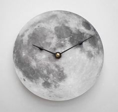 "Full Moon Clock. $17.00, via Etsy. (I'm thinking of taking our old Uncle Milton ""Moon In My Room"" and putting clock parts in it.)"