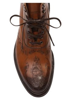 Alexander McQueen Tan Ship Crested Leather Boots ...brings a new meaning to boat shoes.