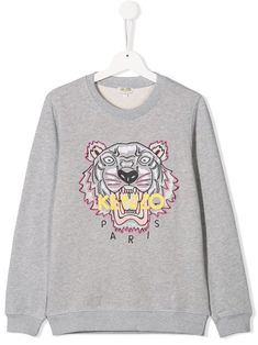 Cool kids will love the new Kenzo Kids' collection. Expect lively prints and signature vibrant-hued dresses, T-shirts and sweats. This grey cotton embroidered Tiger sweatshirt from Kenzo Kids features a round neck, long sleeves and a ribbed hem and cuffs. Grey Sweatshirt, Graphic Sweatshirt, Logo Face, Kenzo Kids, Embroidered Sweatshirts, Kids Logo, Cotton Logo, Cool Kids, Women Wear