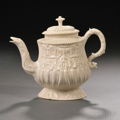 Staffordshire Salt-glazed Stoneware Teapot and Cover, England, c. 1755, oval shape with molded serpent spout and handle, one side with depiction of a tavern scene, the reverse a hunting scene, ht. 5 3/4 in.  Provenance: Frances Katz Collection.
