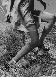 For some reason this makes me think of the Nancy Drew books I used to read... girl running, knee highs and heels on a beach