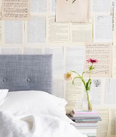 grey fabric headboard + decorations made solely from books? This was designed just for me wasn't it.