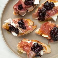 Stewed grapes with prosciutto and ricotta salata pair together in the perfect balance of sweet and salty.