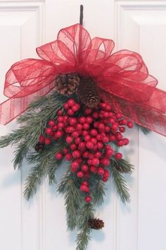 simple red and green Christmas door decor.frothy ribbon, pine branch, and red berries Noel Christmas, Green Christmas, All Things Christmas, Winter Christmas, Christmas Wreaths, Christmas Ornaments, Simple Christmas, Christmas Berries, Cottage Christmas