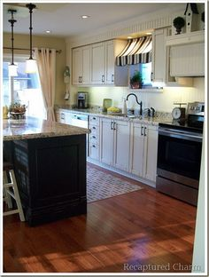 I like the window treatment over the kitchen sink. I am thinking I can do that with two tension rods!!