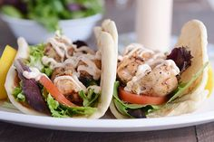 Simple and delicious, grilled lemon chicken wraps are the perfect summer meal. Tender chicken, spicy garlic sauce and soft flatbread - yum! Healthy Sandwich Recipes, Healthy Dinner Recipes, Healthy Snacks, Healthy Eating, Best No Bake Cheesecake, Grilled Lemon Chicken, Chicken Wraps, Garlic Sauce, Chicken Recipes