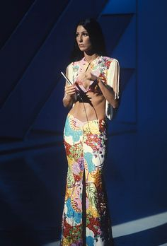 1973: Bell Bottoms | Get your hippie-chic on à la Cher, in floral flares and a coordinating crop top.  REX USA