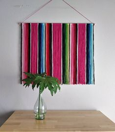 This Mexican Serape Yarn Wall Hanging is inspired by the classic Mexican serape . Mexican Style Decor, Mexican Kitchen Decor, Mexican Blanket Decor, Mexican Wall Decor, Mexican Blankets, Mexican Bedroom, Yarn Wall Hanging, Wall Hangings, Colorful Wall Art
