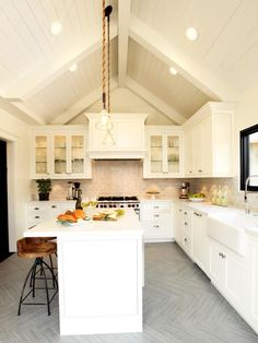 Designer Christopher Grubb transform a tired kitchen into a welcoming heart of the home with white cabinetry, porcelain-tiled floors and a vaulted ceiling on HGTV.com