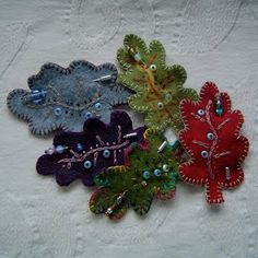 here's one I made earlier: Felt Leaf Brooches