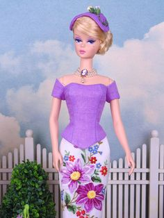 """Fully lined pencil skirt, corset top and matching hat for 12"""" fashion dolls. These separates are made from a vintage orchid linen hankie and a vintage hand worked petit point hankie. Hatband is decorated with mulberry paper rosebuds. These separates were sewn entirely by hand and lined"""