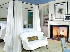 This master bedroom outside of Atlanta, Georgia is a soothing retreat, with white walls and bed curtains creating a clean backdrop for a range of blues. (Photo: Keith Scott Morton)