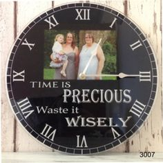 Clock : 3007- Time is precious black  Time is precious...  PRODUCT PERSONALISATION - ONE PHOTO CHANGE, COLOUR CHANGE IF REQUIRED     Personalised clock  Our personalised clocks have the 'WOW' factor and are even more stunning in real life!  Clocks are Approx 30cm x 30cm diameter, with a working clock mechanism and antique style hands, printed onto a 3mm acrylic glass using top of the range laser printers.  (Clocks take one AA battery, battery not included)