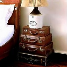 vintage suitcases - would be cute with the older hard plastic retro suitcases in fun colors