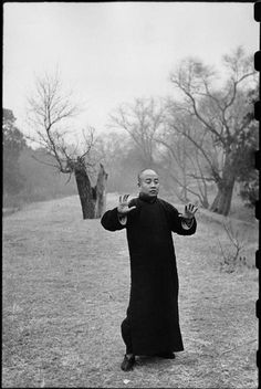 Henri Cartier-Bresson CHINA. Beijing. December 1948 Tai Chi Chuan in the Tai-miao Gardens