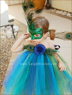 beautiful girl's peacock halloween costume! We don't have halloween but my girl would wear this every day of the week if she had it!