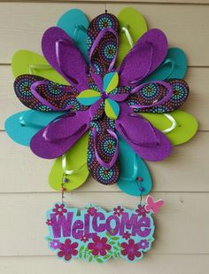fe24347f45705 Summer flip flop wreaths - what a cute craft to hang on a door ...