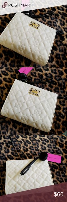 SALE TODAY ONLYBETSEY JOHNSON QUILTED WRISTLET NWT-BETSEY JOHNSON HEART QUILTED DESIGN PURSE/WRISTLET!  THIS BEAUTIFUL DESIGN OFFERS A ZIPPER ENCLOSURE AND A WRISTLET HANDLE FOR EASY CARRYING. BEAUTIFUL DETAIL INSIDE AND OUT & PLENTY OF ROOM FOR ALL YOUR NEEDS. THIS IS JUST AN AMAZING FIND!   NWT- BRAND NEW WITH TAGS 100% AUTHENTIC SAME DAY SHIPPING OFFERS ACCEPTED THROUGH THE OFFER BUTTON NO TRADES   PLEASE FOLLOW BOUTIQUE RULES AND BE RESPECTFUL THIS IS A BUSINESS THANK YOU Betsey Johnson…