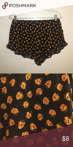 Brandy Melville Flowy Patterned Shorts Black/yellow flowered flowy shorts, ruffles on the bottom Brandy Melville Shorts