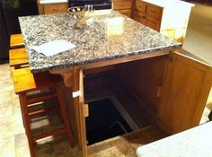 Secret Room Entrance in Kitchen Island.  Perfect for that hidden wine cellar and access to the well hidden under the kitchen floor.