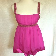 BEBE BABYDOLL CORSET XXS FUSHIA PINK BEADED TOP Fitted at the top to create a lifted busy area. Adjustable straps. Side zipper. Tag reads XXS. FEATURES BEADED SILVER ACCENTS. IN A RICH FUSHIA COLOR. bebe Tops Blouses