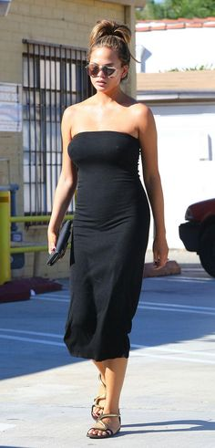 Pregnant Chrissy Teigen has been dressing plenty sexy, including a curve-hugging strapless t-shirt dress (with no bra!) Click for more of her best maternity style moments