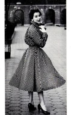 Model in a polka-dotted coat dress for LIFE Magazine, 1954.