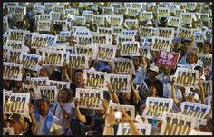 People hold placards denouncing Prime Minister Shinzo Abe's security legislation during an anti-government rally in Tokyo on Friday. | REUTERS(7/24/2015)