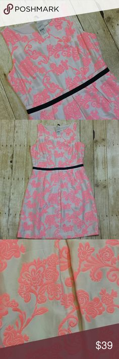 """Loft NWT Petite Brocade Sleeveless Dress Loft Petite Brocade Sleeveless dress. Nude background with hot pink brocade floral design. Black sash at waist with pleats peeking out. Rear has exposed zipper. Brand new with tags. Size 6P. Retail: $98  Reasonable offers encouraged or bundle and save.  Measurements  Pit to Pit 17.5"""" Waist 15.5"""" Top of shoulder to bottom hem 35"""" LOFT Dresses Midi"""