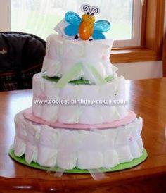 Homemade Diaper Cake... This website is the Pinterest of diaper cake ideas