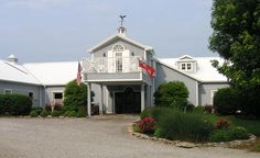 Turn-key equine facility minutes from the Kentucky Horse Park. The 10,000 +/- SF structure houses a  2,700 +/- SF home with covered porch; 8 stalls; wash stall; feed room; tack room; half bath; storage; office; barn apartment; 40' x 70' indoor arena; viewing/seminar room; fitness room; healing room; and full bath. Also - a 3 stall barn with attached run-in shed; equipment and hay storage building; 2 more run-in sheds; and a 100' x 200' outdoor arena. $1,250,000. Kentucky Horse Park, Indoor Arena, Barn Apartment, Run In Shed, Bath Storage, Workout Rooms, Built In Storage, Full Bath, Sheds