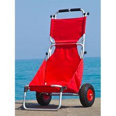 Red folding beach chair near the lake