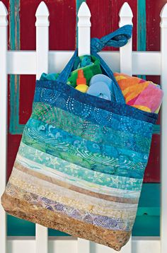 Seashore Satchel Create a fun beach bag with scraps of batiks and batting. Designed by: June Dudley, QM Executive Editor Skill Level: Easy Techniques: Pieced Size: Tote bag Appears in July/August quiltmaker Ocean Quilt, Beach Quilt, Patchwork Bags, Quilted Bag, Fabric Crafts, Sewing Crafts, Diy Crafts, Quilting Projects, Sewing Projects