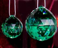 Deep Emerald Swarovski Crystals. I'd love to hang one of these in a sunny window or in my car =)